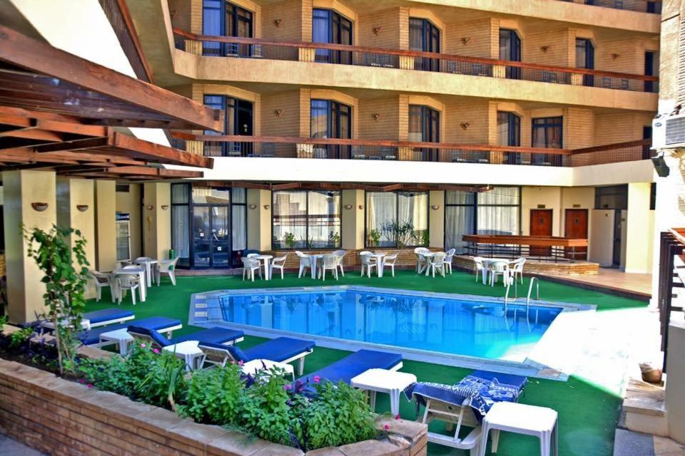 The swimming pool at or near Gaddis Hotel, Suites and Apartments