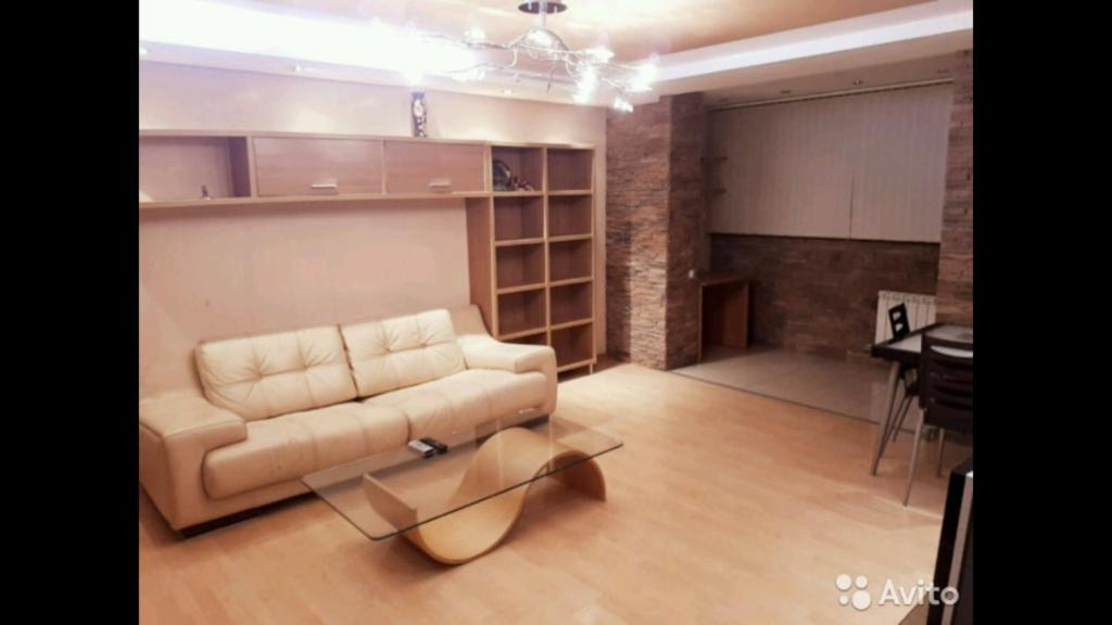 A seating area at Квартиры посуточно