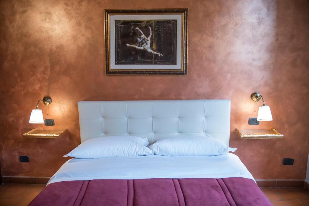 Letto o letti in una camera di Casa Navona