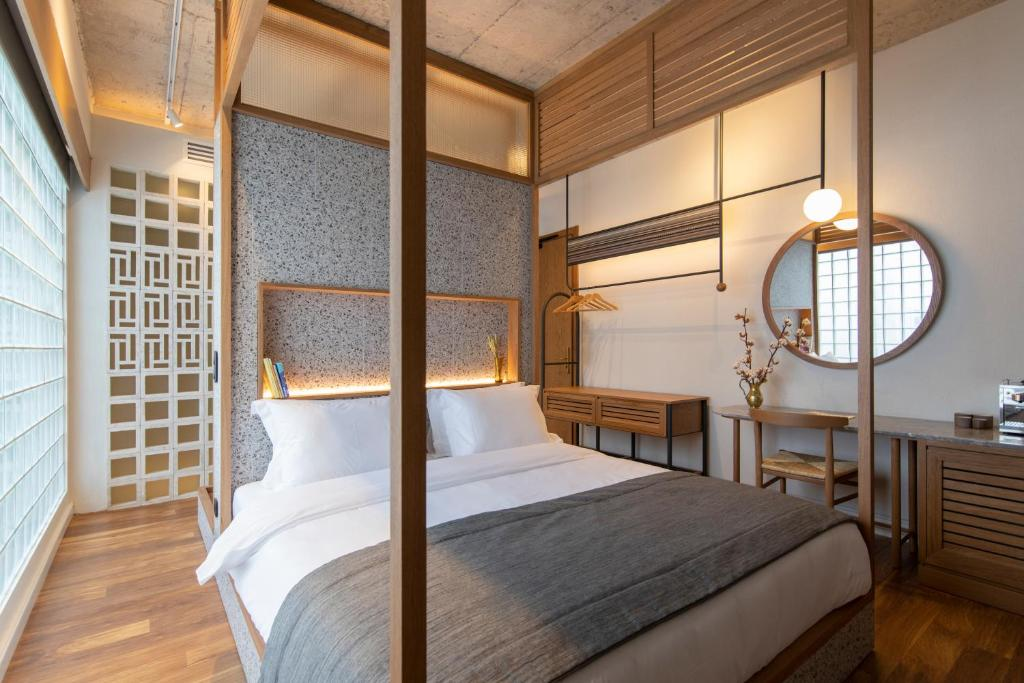 A bed or beds in a room at Ergon House