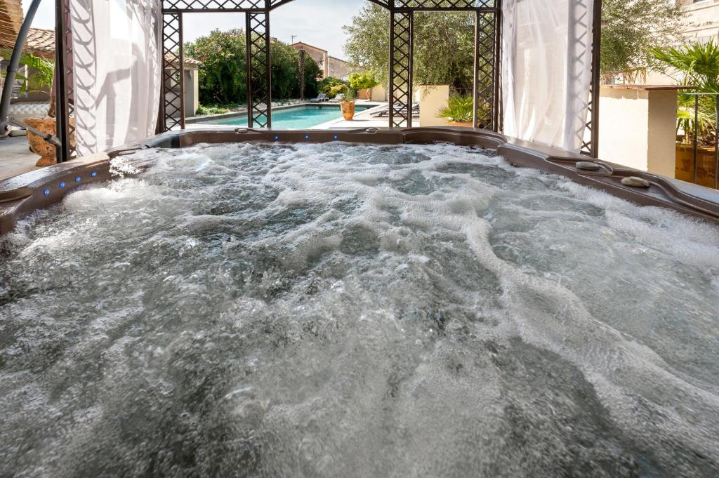 The swimming pool at or near Mas De L'ilon