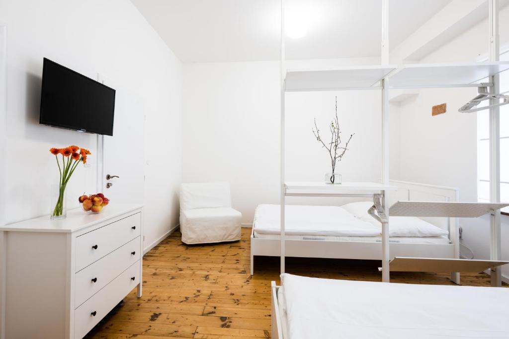 Postel nebo postele na pokoji v ubytování Guesthouse Slavia