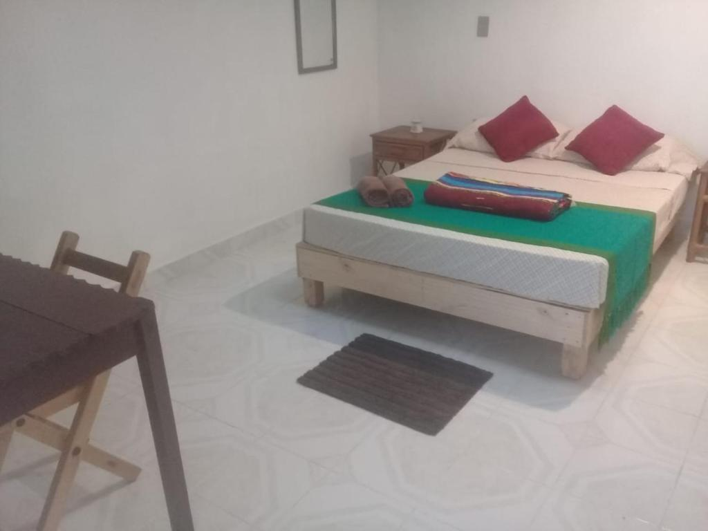 A bed or beds in a room at Casa Natura