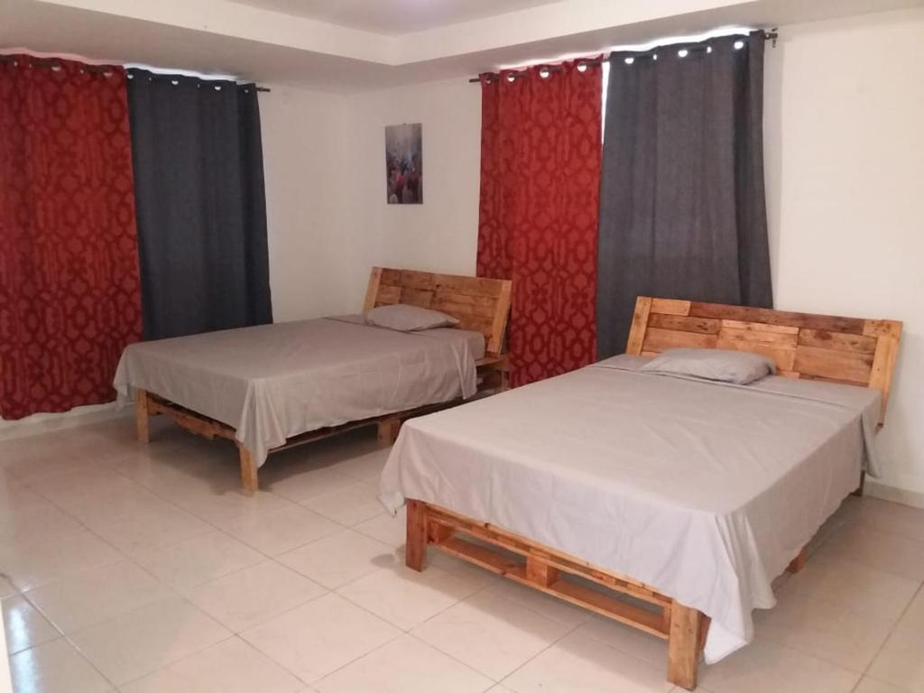 A bed or beds in a room at Very Good House