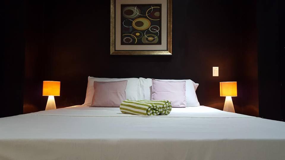 Letto o letti in una camera di Casita Isla Beach Inn