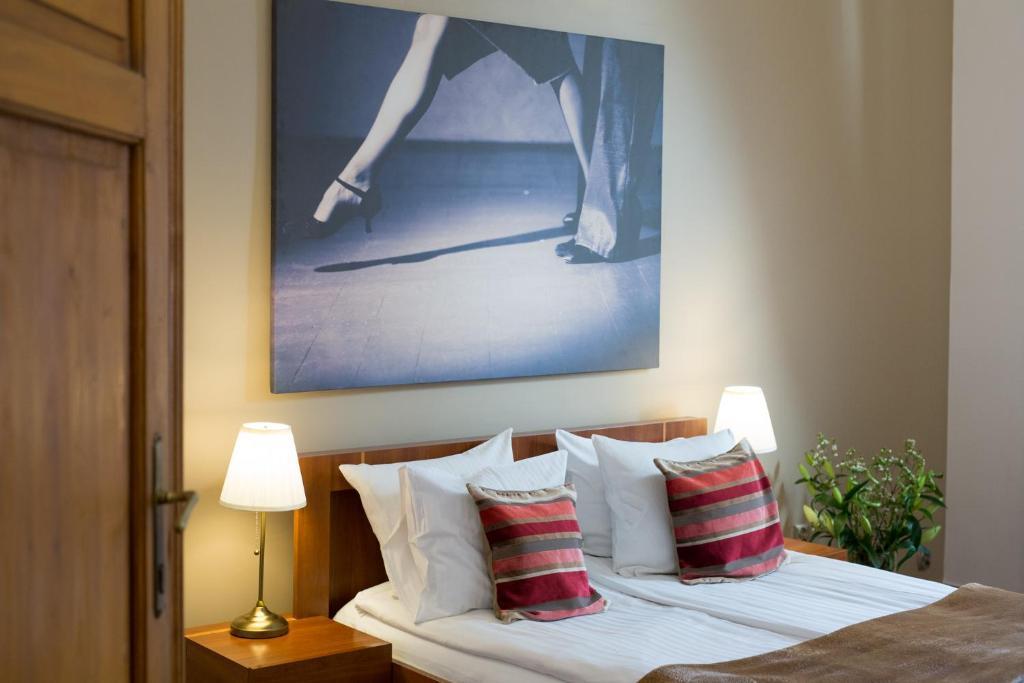 Кровать или кровати в номере Tango House Bed & Breakfast