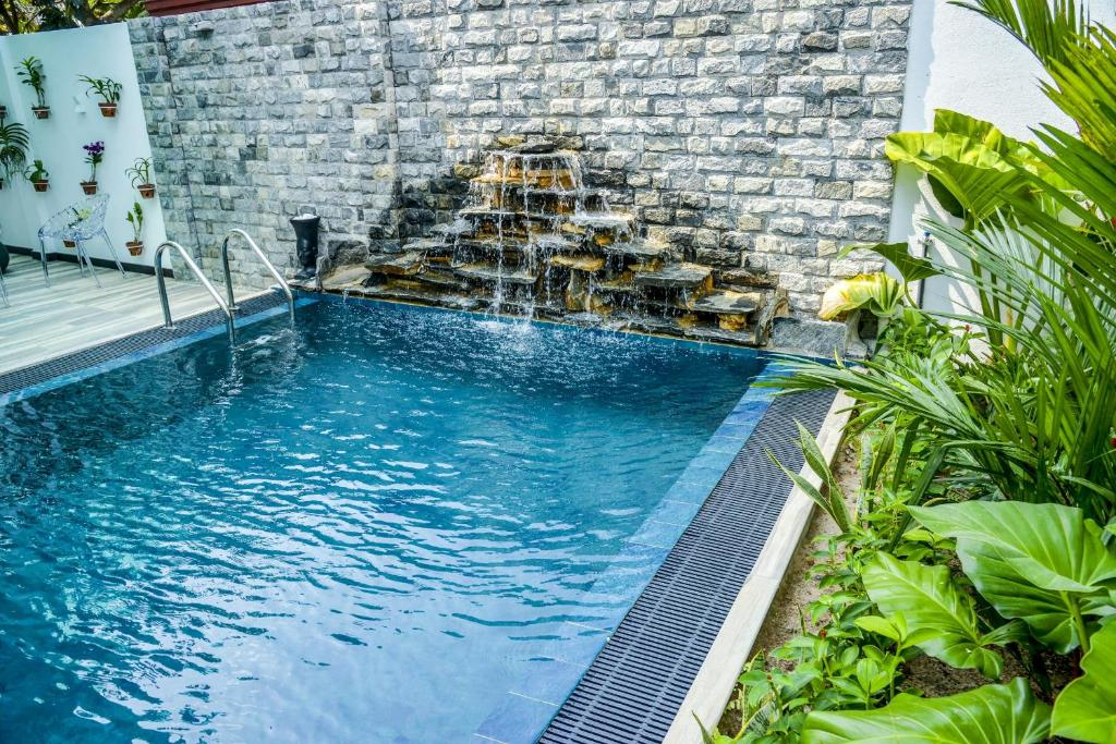 The swimming pool at or near Negombo New Queen's Palace