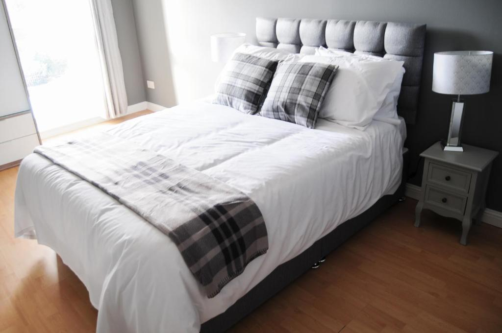 A bed or beds in a room at Home Stay in Alexandra Parade – near City Centre