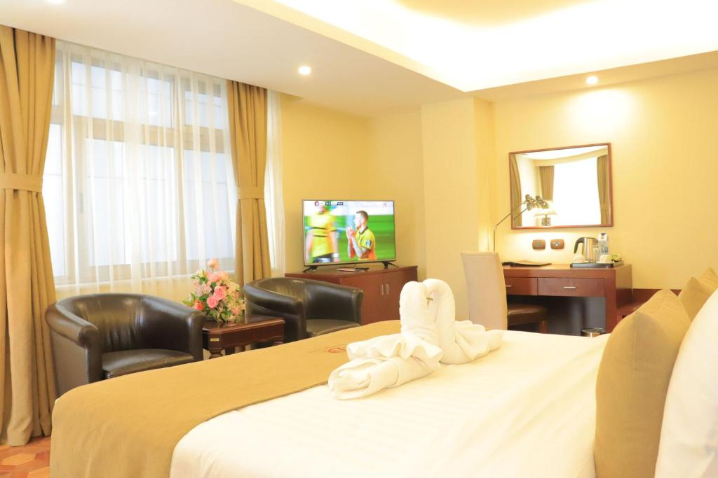 A television and/or entertainment center at Desalegn Hotels and Resort