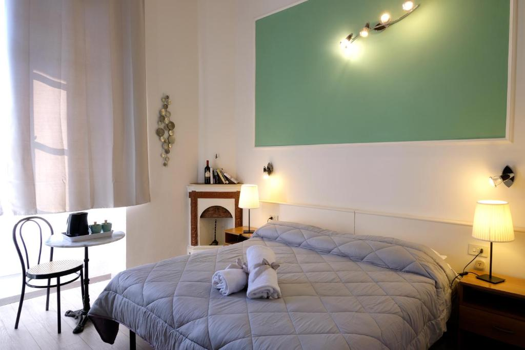 A bed or beds in a room at Residenza Le Rondini