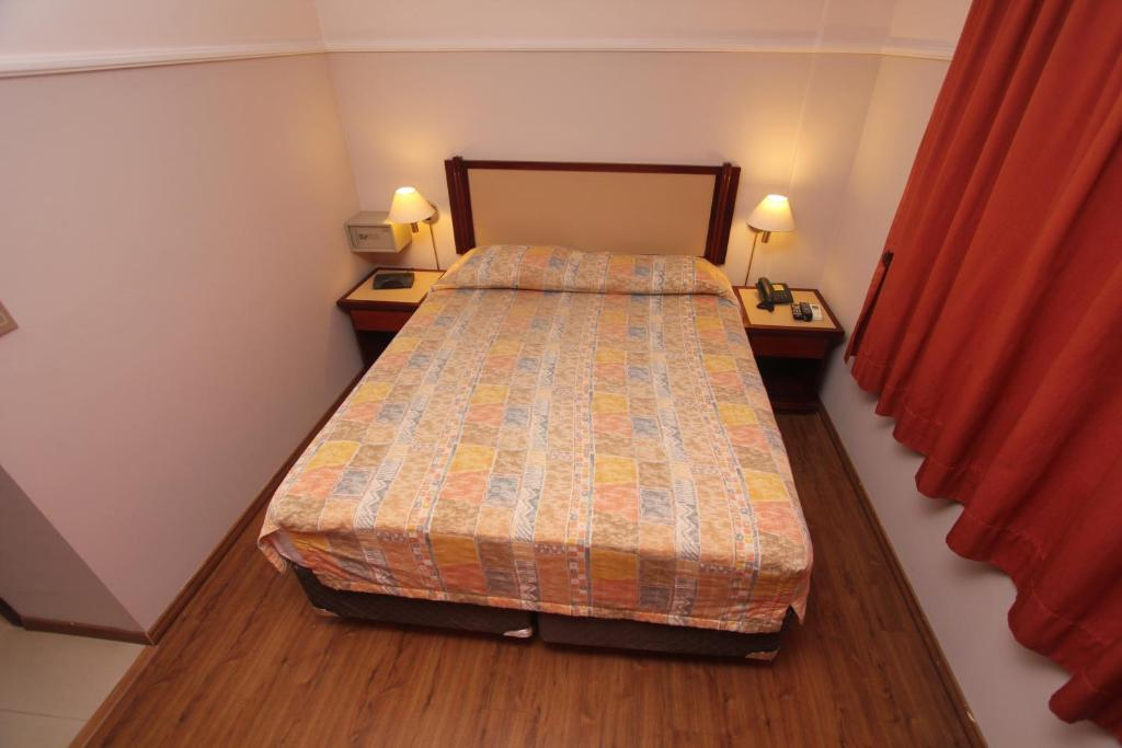 A bed or beds in a room at Nena Suite Hotel