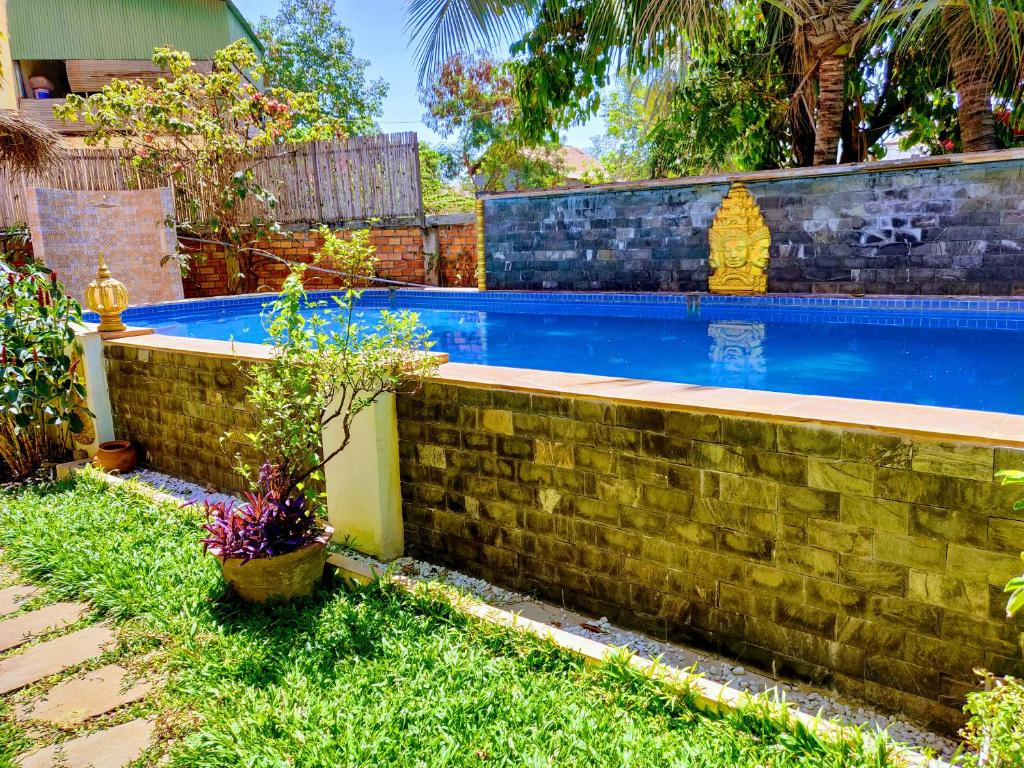The swimming pool at or near The Cashew Nut Villas