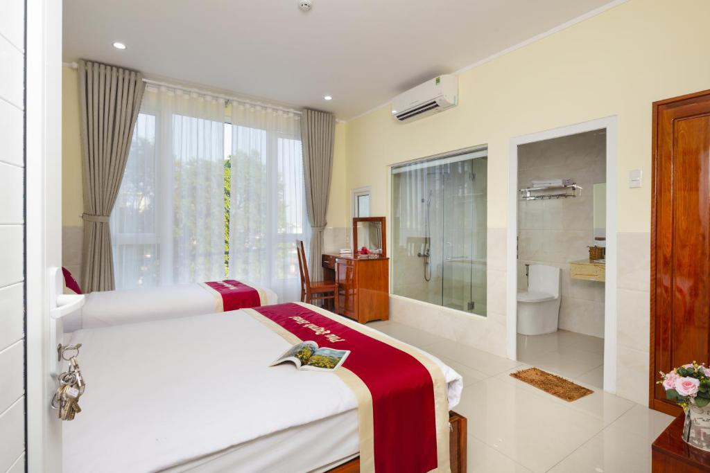 A bed or beds in a room at Phu Quynh Hotel