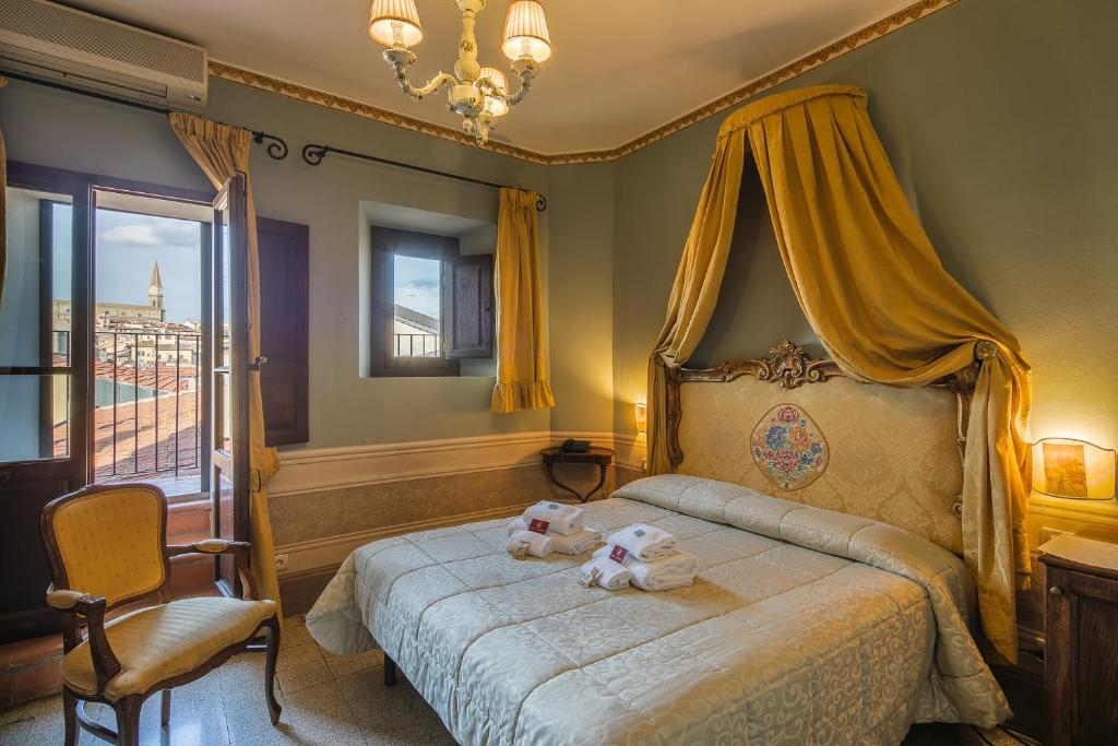 A bed or beds in a room at I Portici Boutique Hotel