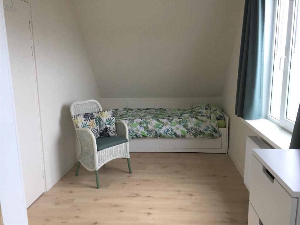 Ein Sitzbereich in der Unterkunft Pension Zandvoort aan Zee