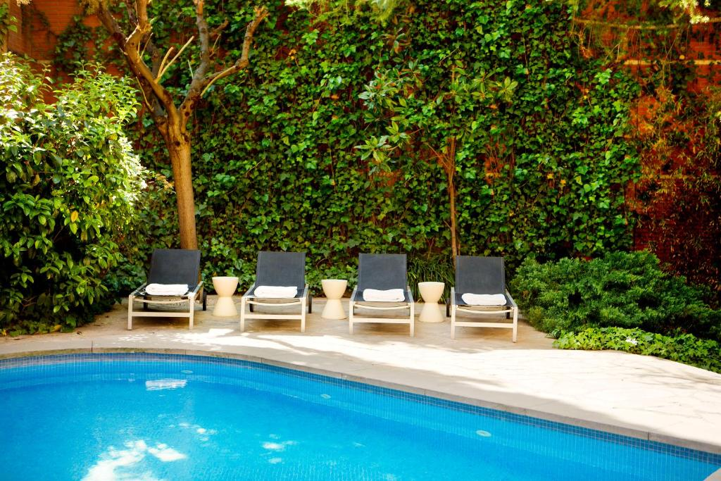 The swimming pool at or near Hotel Balmes