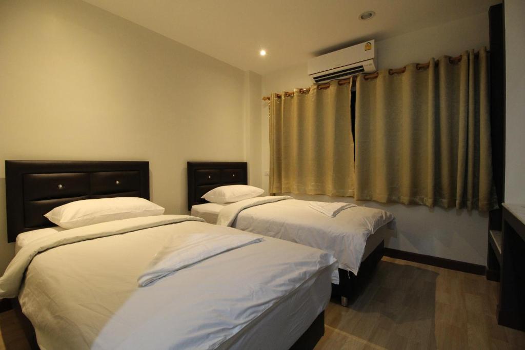 Cama o camas de una habitación en Chaiwat Guesthouse