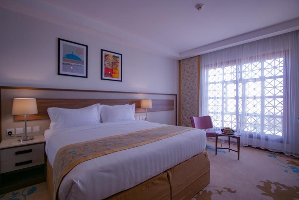 A bed or beds in a room at Bosphorus Waqf Al Safi Hotel