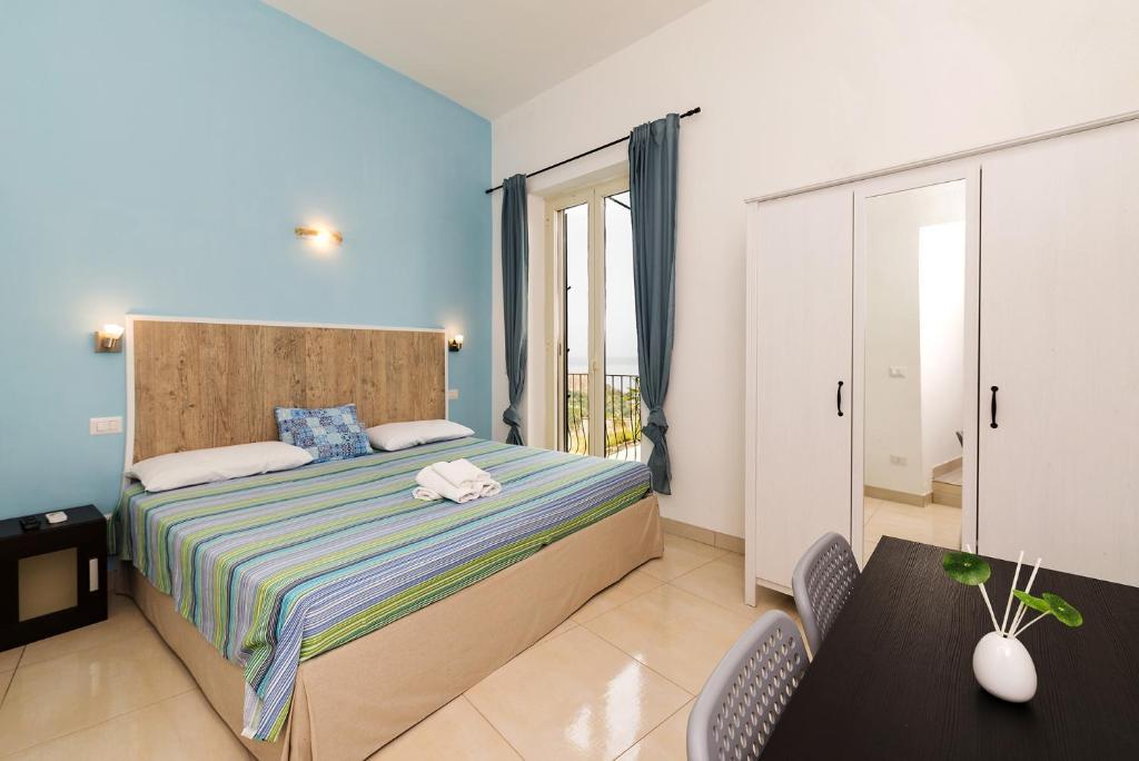 Katil atau katil-katil dalam bilik di Aequa Rooms