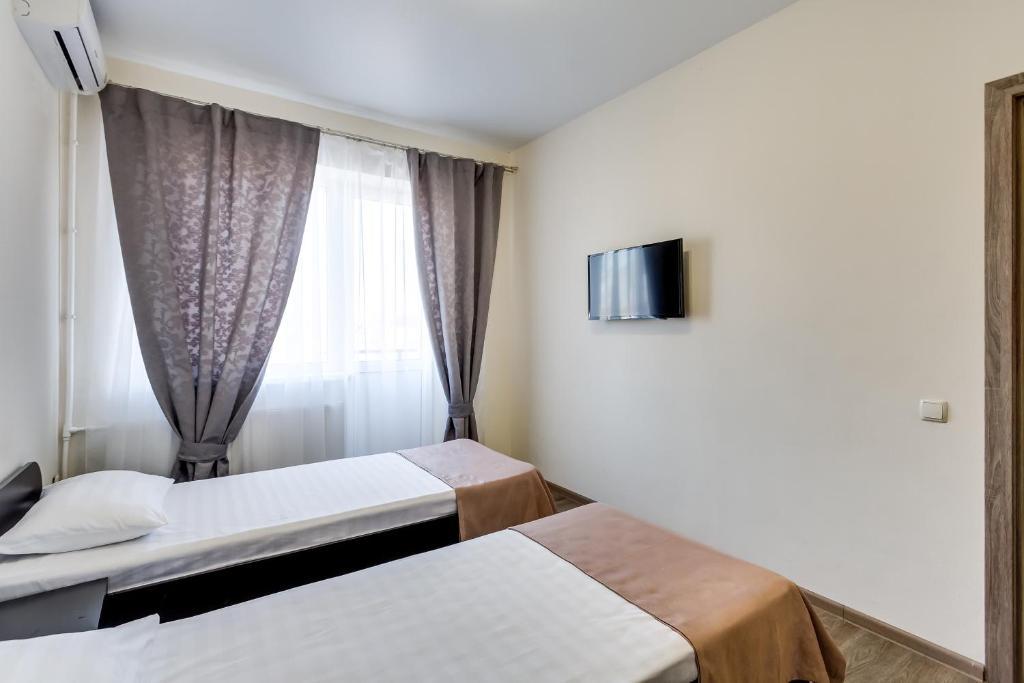 Кровать или кровати в номере Апарт-отель Грин Холл