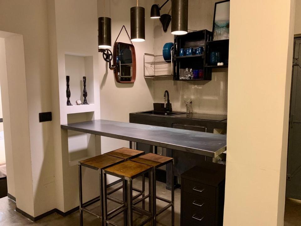 A kitchen or kitchenette at Fra Storia e Modernità