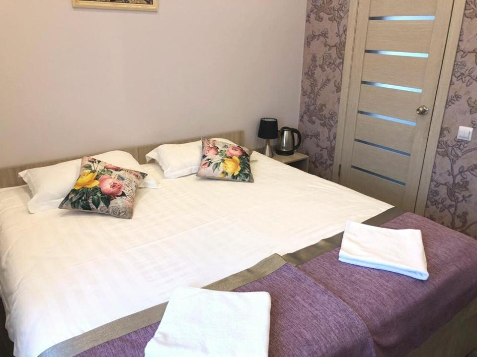 A bed or beds in a room at Yakovlev hotel