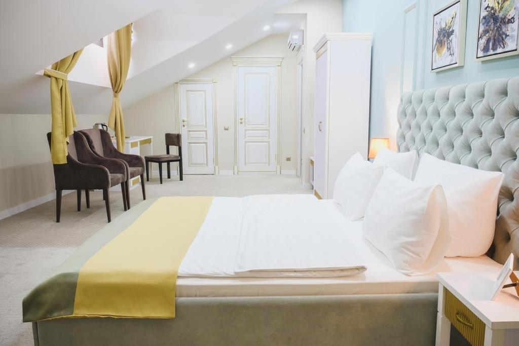 A bed or beds in a room at Stoleshnikov Boutique Hotel