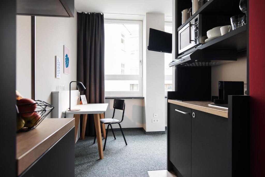 Küche/Küchenzeile in der Unterkunft HUB-Apartments