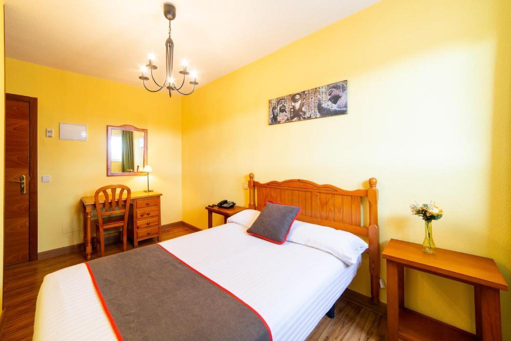 Cama o camas de una habitación en OYO Hotel Mavi