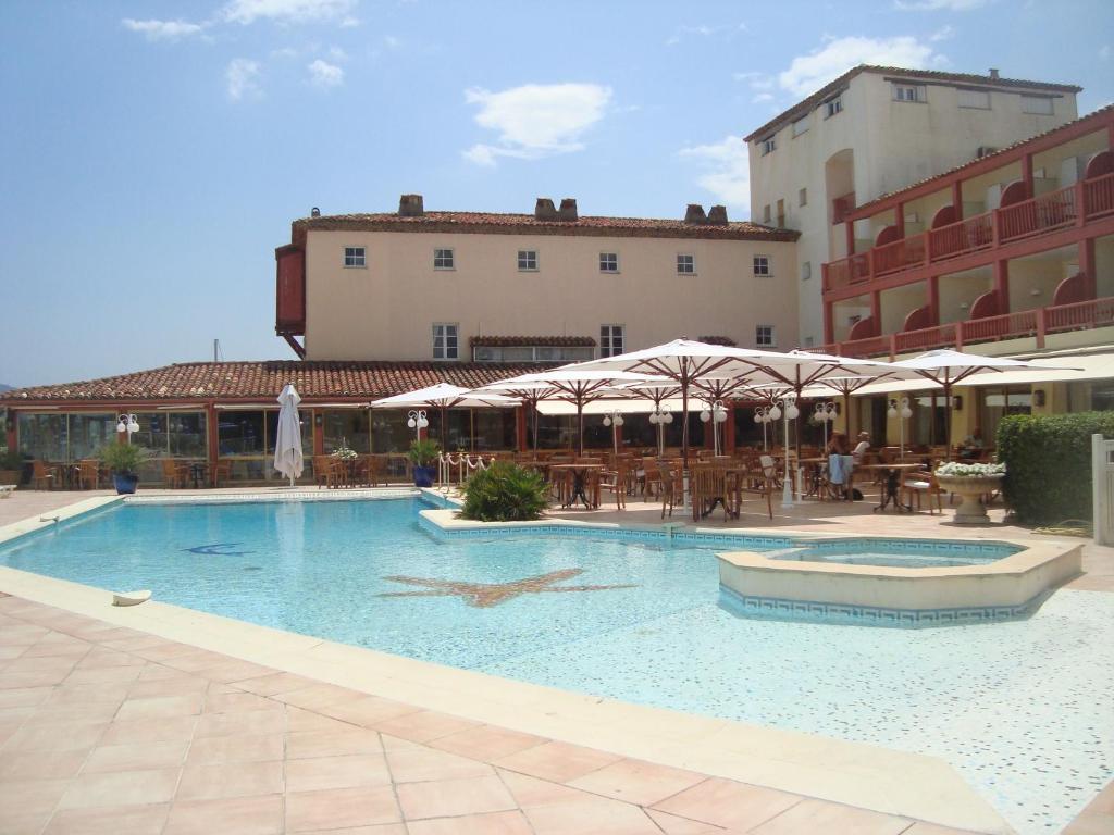 The swimming pool at or near Hotel Giraglia