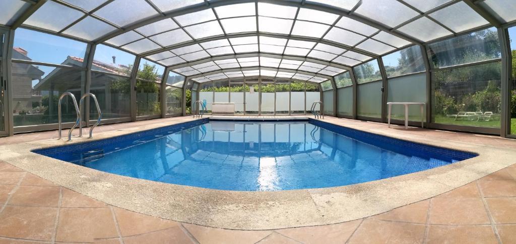 The swimming pool at or near Apartamentos Cruceiro