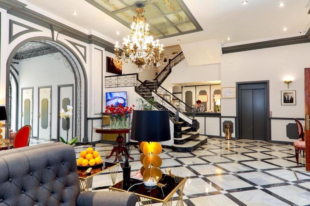 The lobby or reception area at Hotel Sevilla