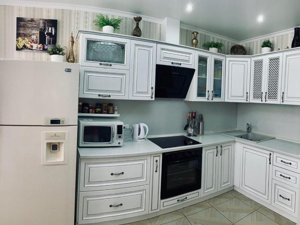 A kitchen or kitchenette at Rooms on Petra Metalnikova 7