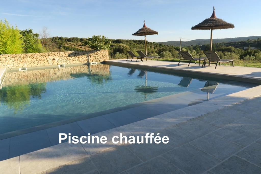 The swimming pool at or near Le Clos d'Estellan - Heated Pool