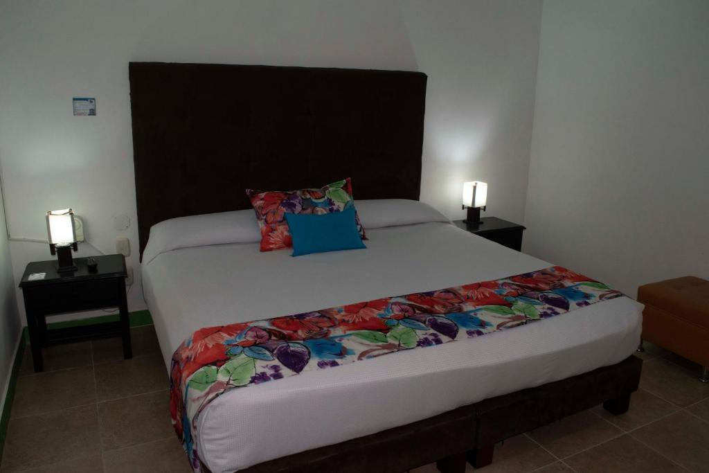 A bed or beds in a room at Finca Hotel La Tata