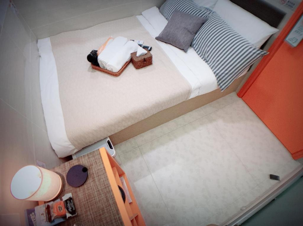 A bed or beds in a room at Sleeplicity