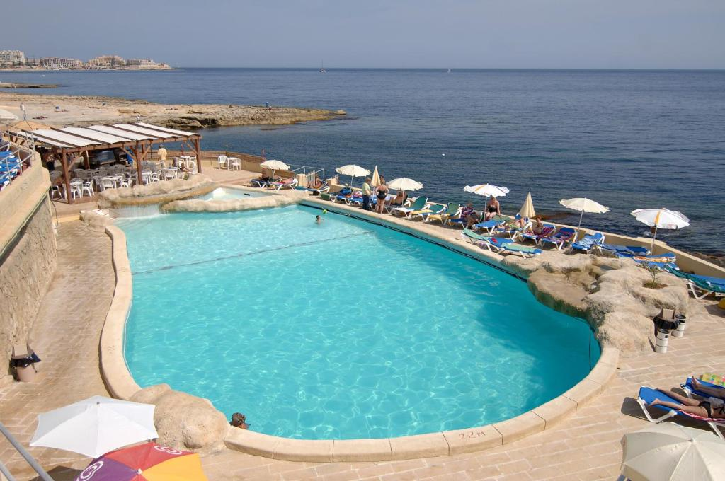 A view of the pool at The Preluna Hotel or nearby