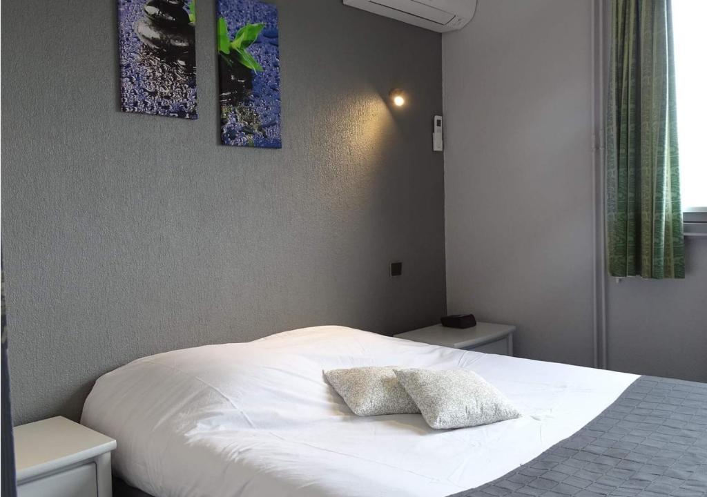 Un ou plusieurs lits dans un hébergement de l'établissement Europa Hotel