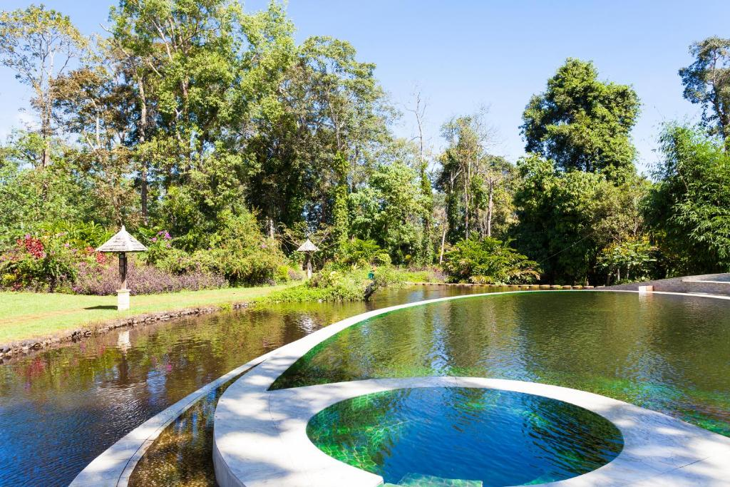 The swimming pool at or near Sinouk Coffee Resort
