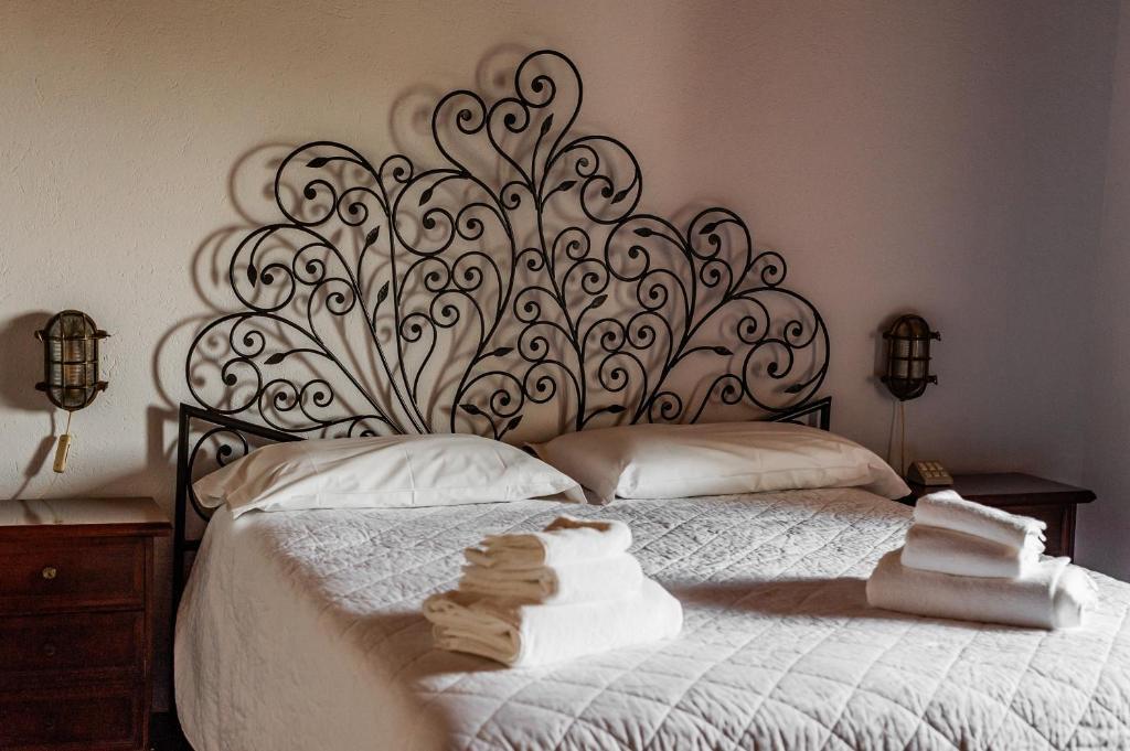 Gulta vai gultas numurā naktsmītnē Hotel Bellavista