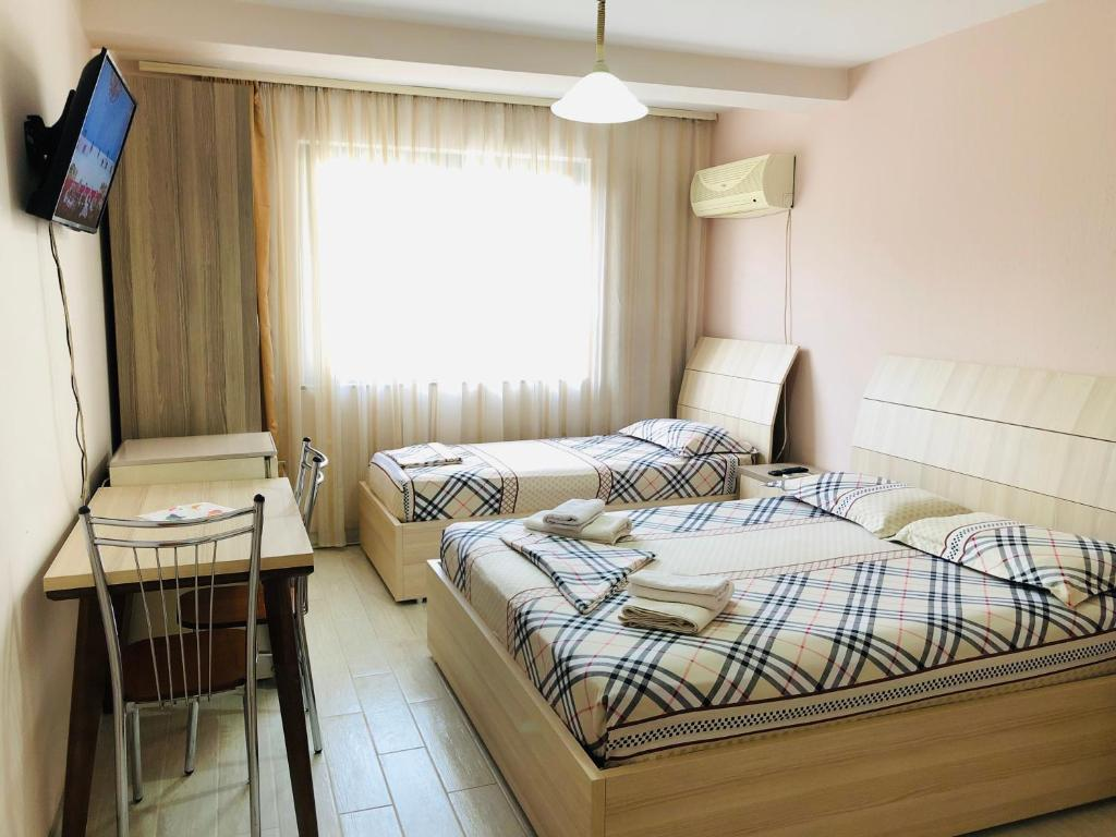 A bed or beds in a room at Central Tirana Apartment