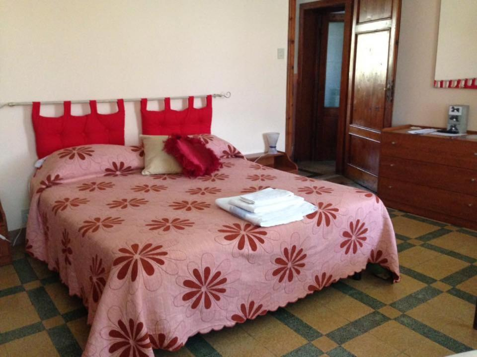 A bed or beds in a room at Il Mattacchione