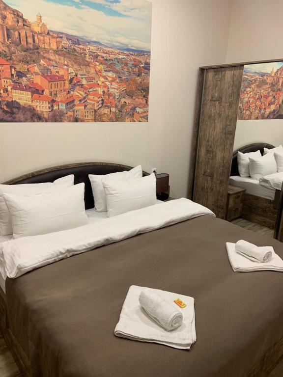 Кровать или кровати в номере Sweet Rooms Inn