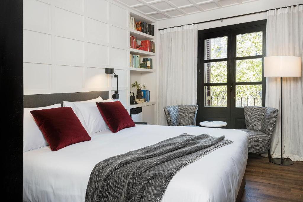 A bed or beds in a room at Boutique Hotel Casa Volver