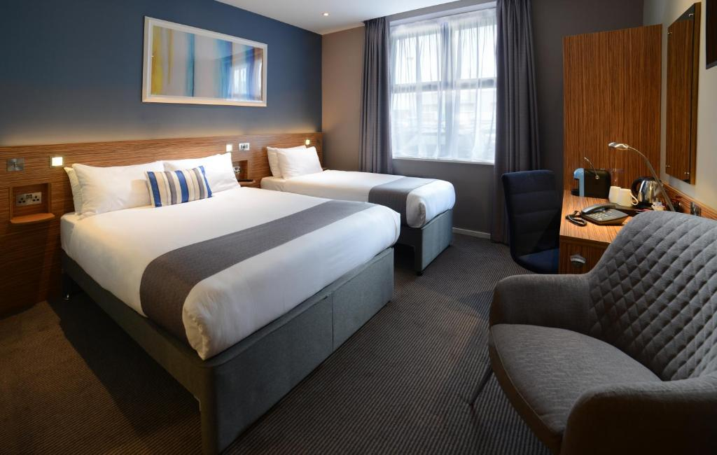A bed or beds in a room at Travelodge Galway