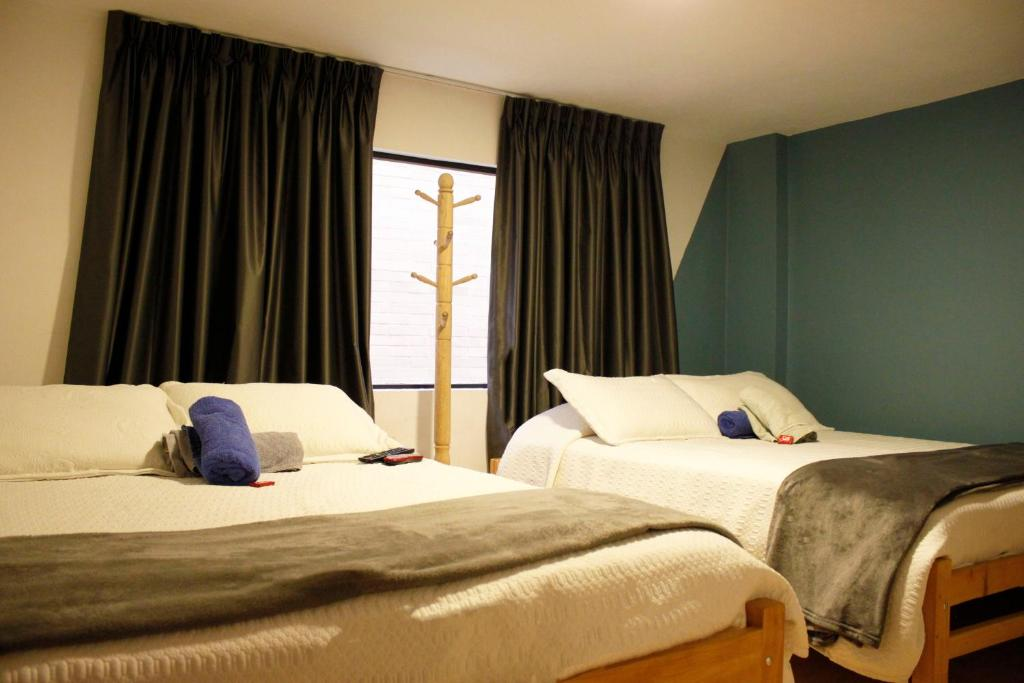 A bed or beds in a room at Rua Hostels - Bogota