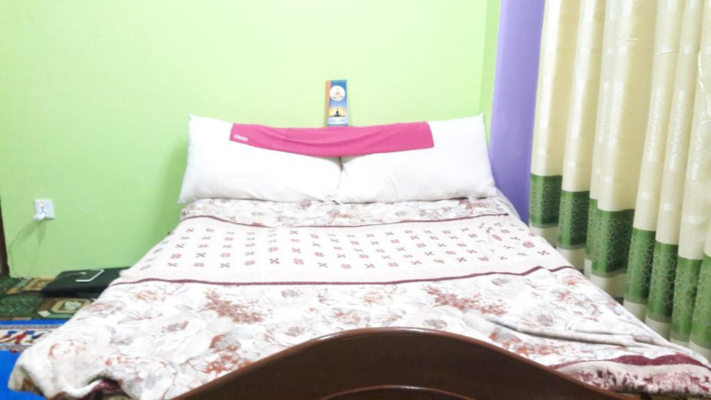 A bed or beds in a room at Home way Home
