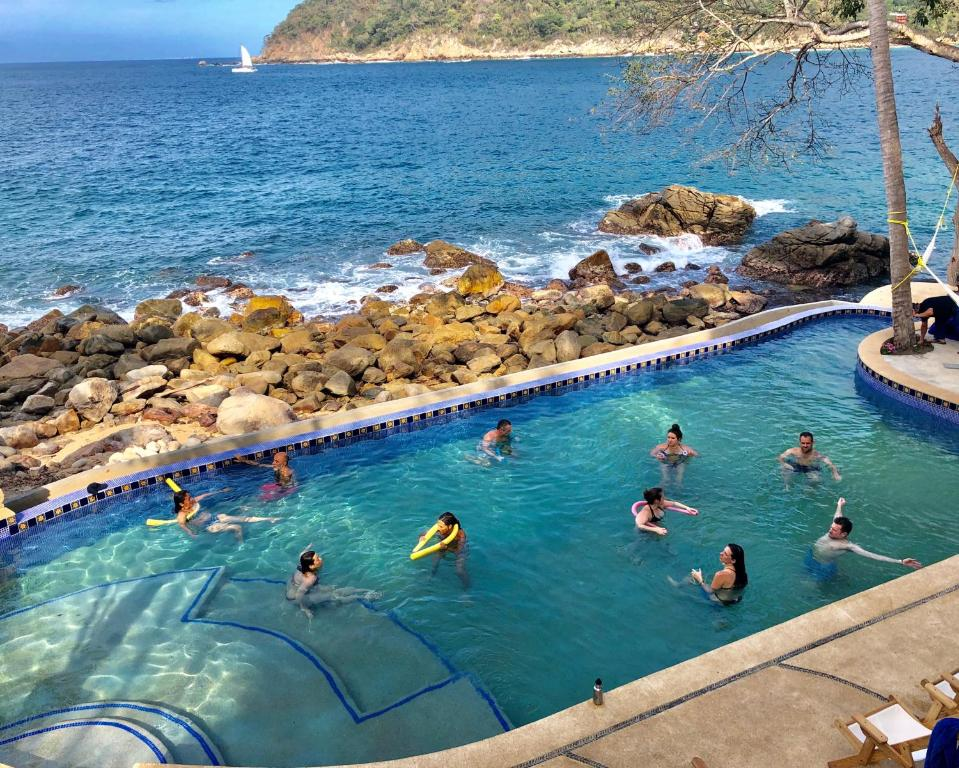 A view of the pool at Pura Vida Wellness Retreat or nearby