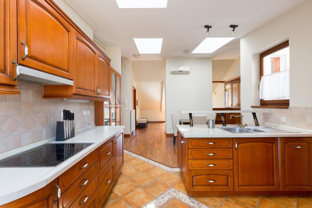 A kitchen or kitchenette at The Cathedral Rooftop Terrace