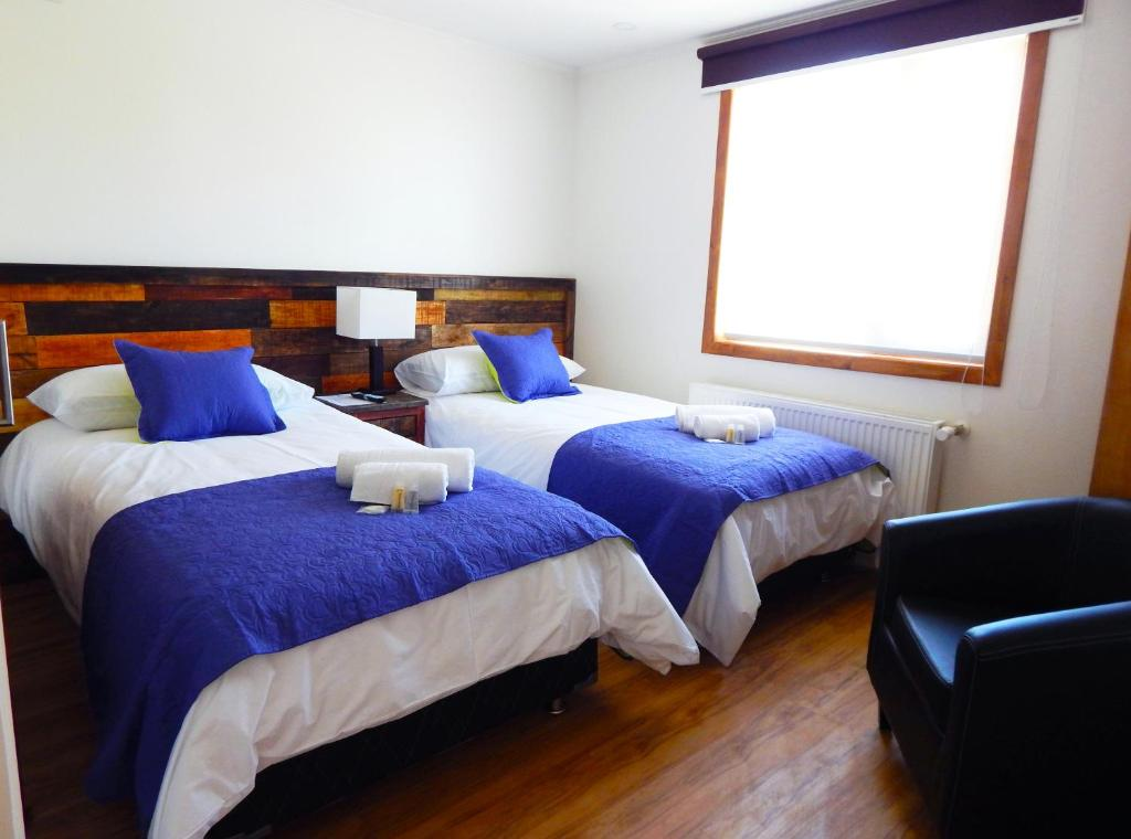 A bed or beds in a room at Hostal Buenavista Patagonia